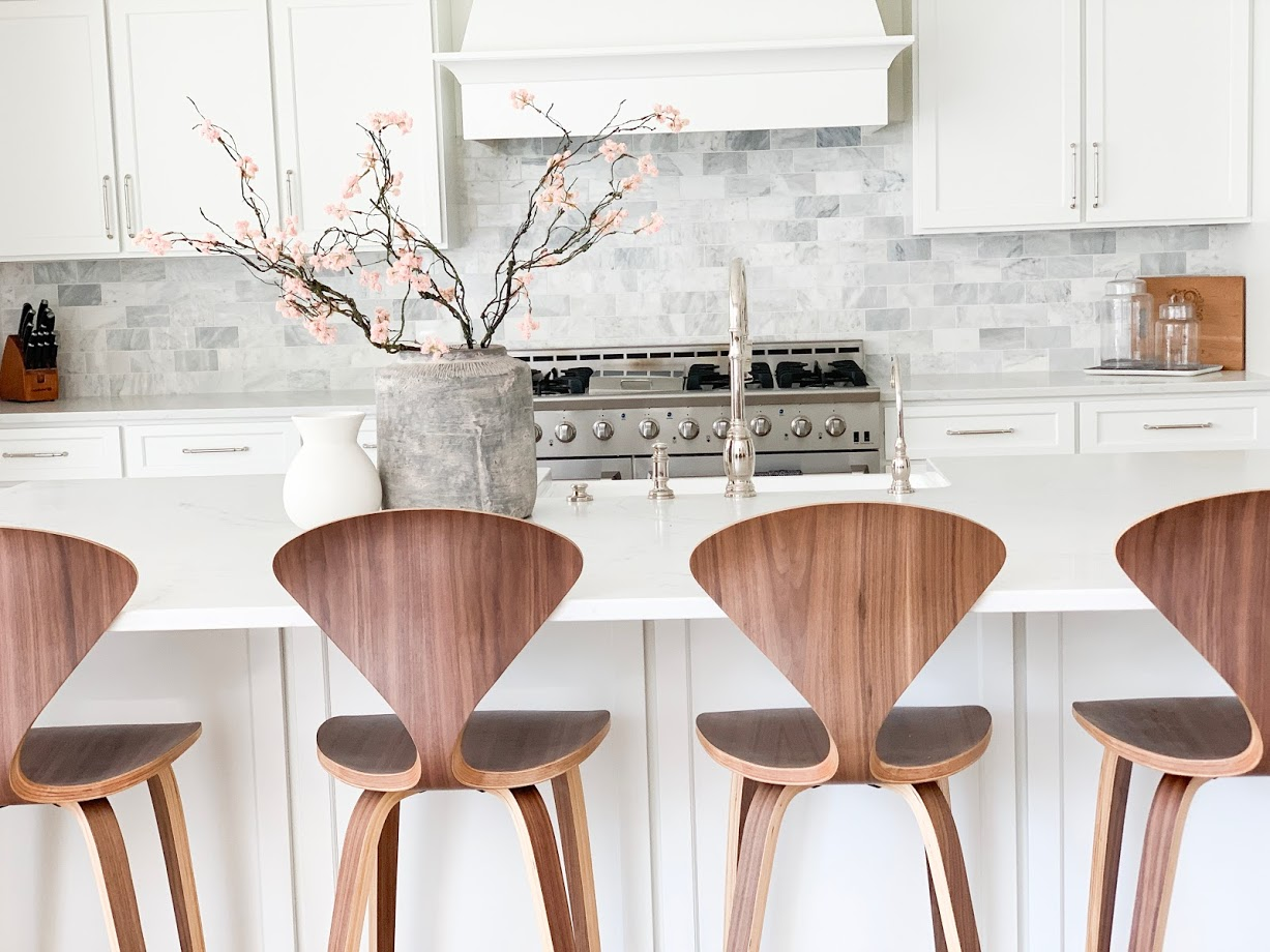 waterstone, faucet, counter stools, wood stools, wood and white, white kitchen
