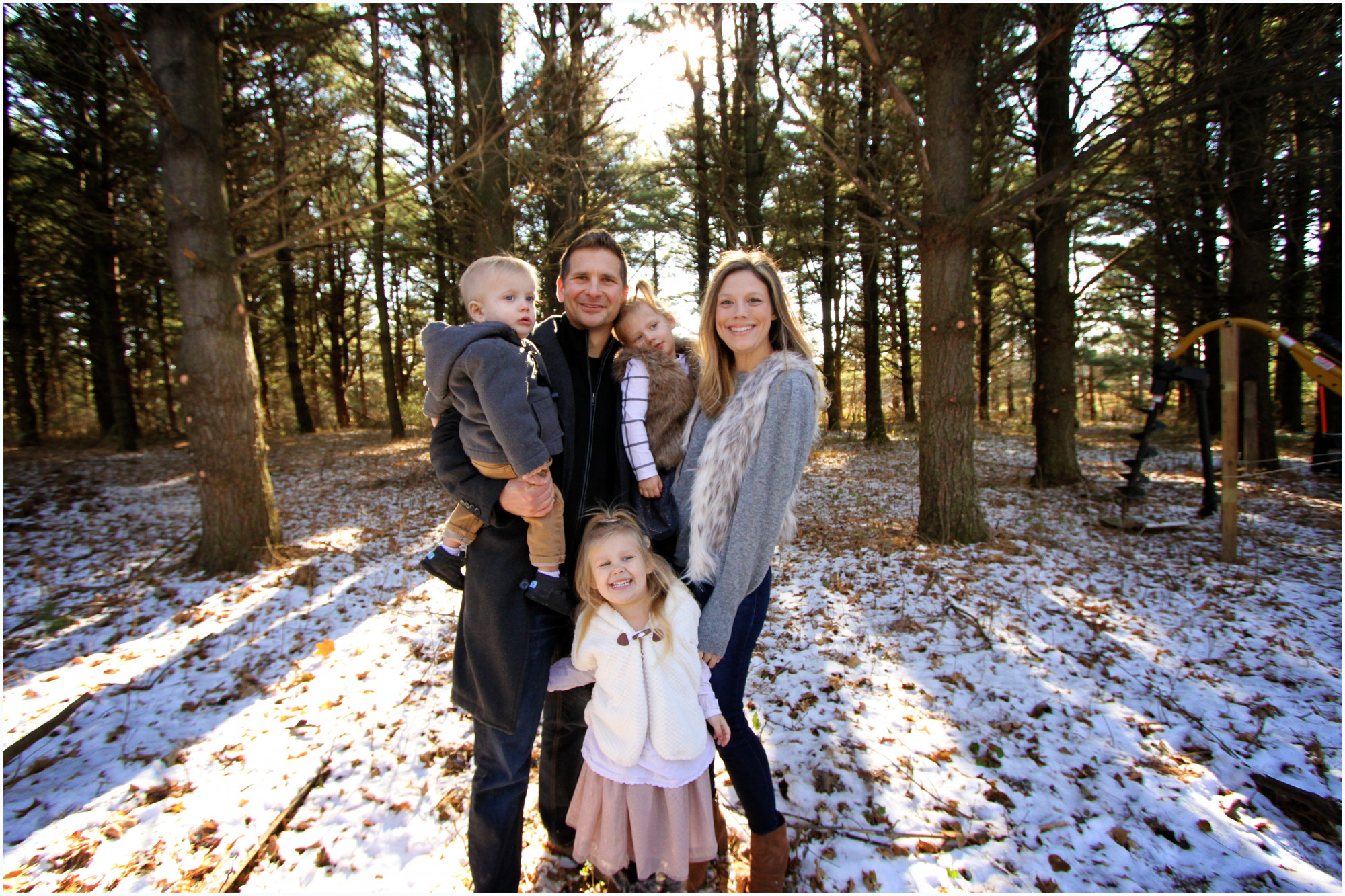 family photo in the woods with snow on ground