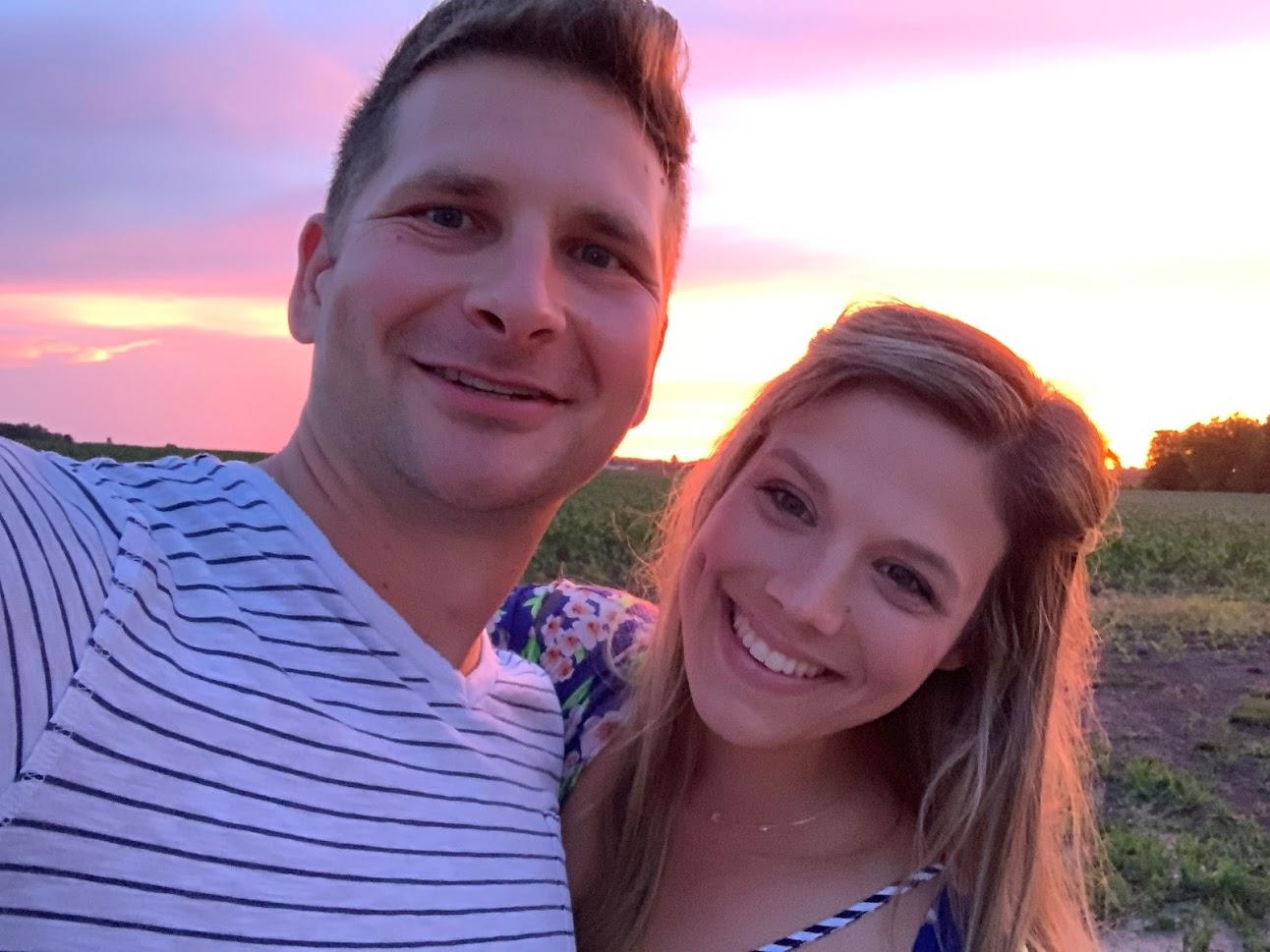 husband and wife sunset photo, stripe shirt