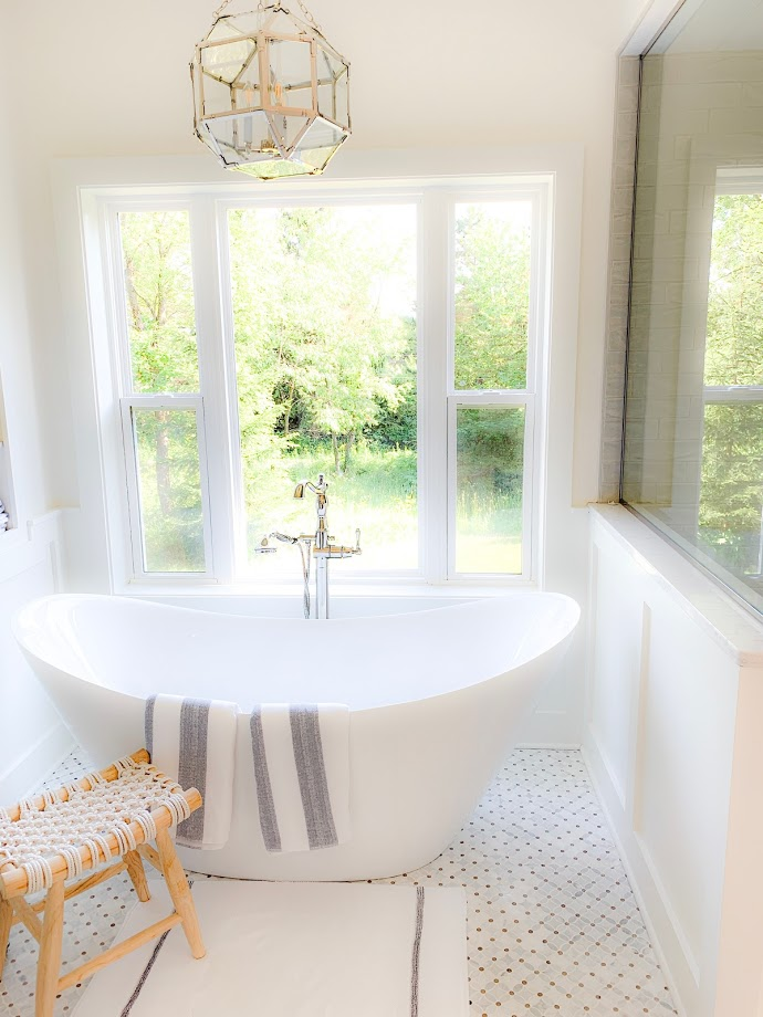 morris chandelier hung over bath tub