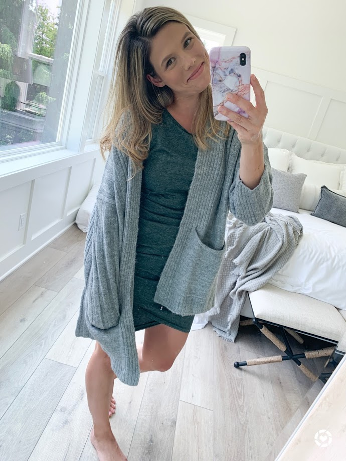green dress with gray cardigan, selfie with phone