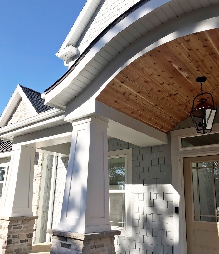 front porch with cedar arched ceiling and porch columns