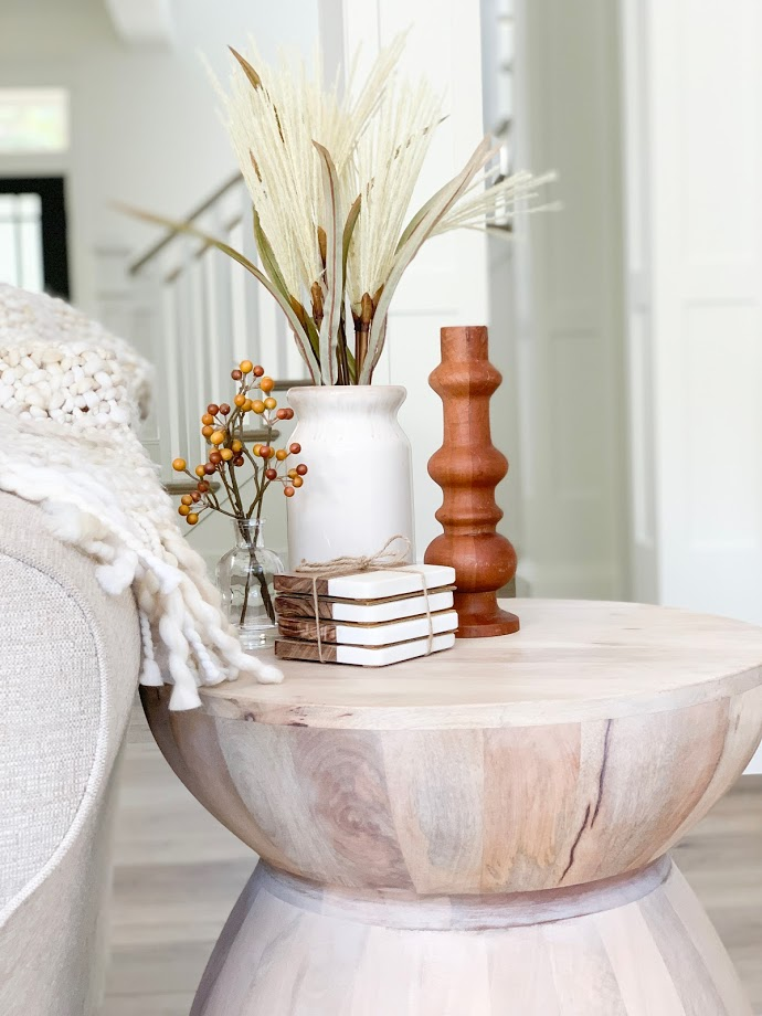 wood end table with fall decor, vase with spray